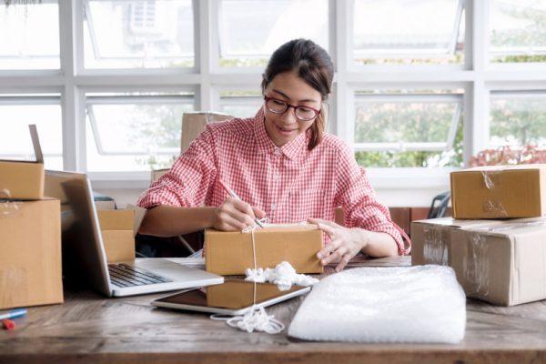 woman packaging orders