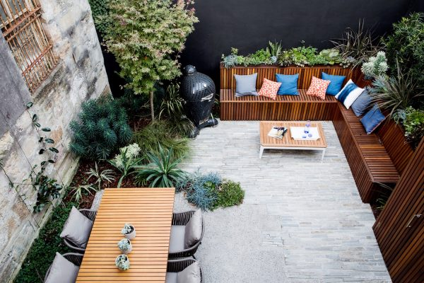 a stunning outdoor space with wooden benches and plants