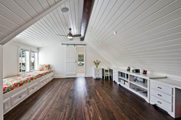 an attic with dark wooden flooring