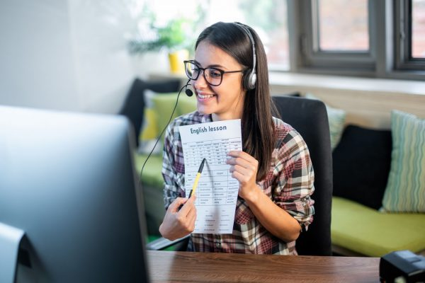 a woman teaching english online