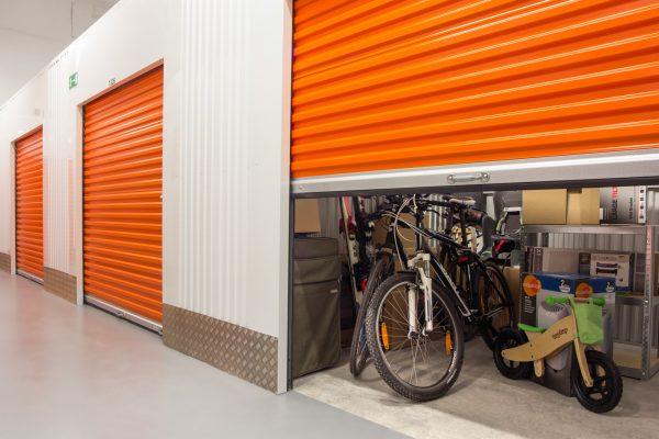 bikes stored in an orange storage unit