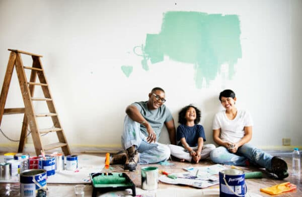 a young family sitting on the floor of their living room during renovation