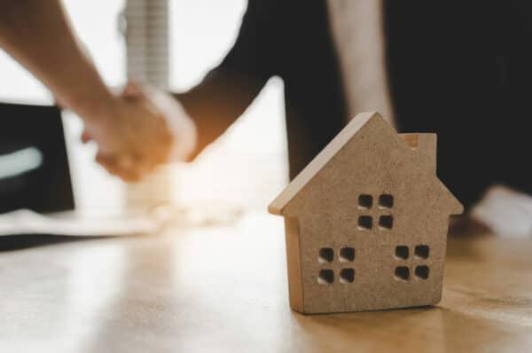 real estate brokers shaking hands