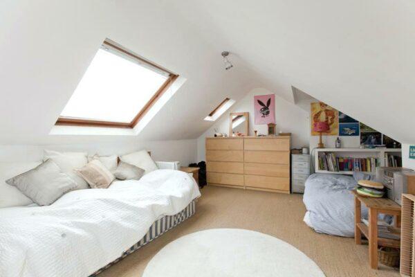 a small dormer bedroom in the attic