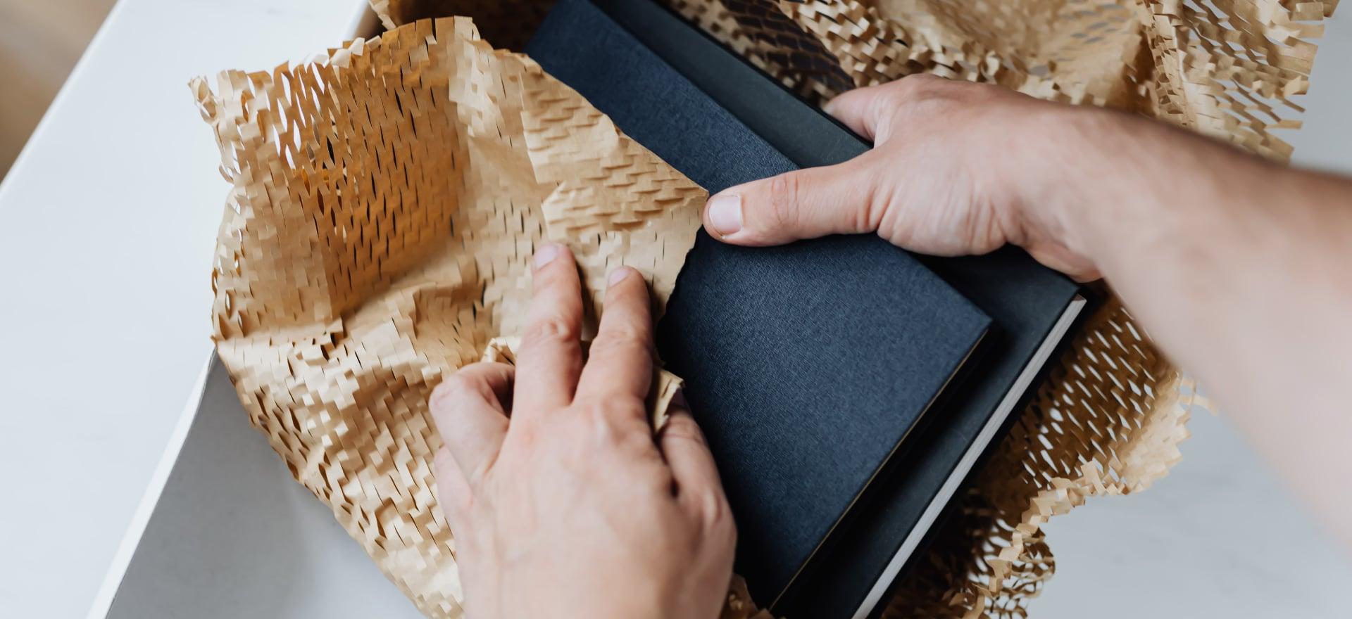 A person unwrapping books