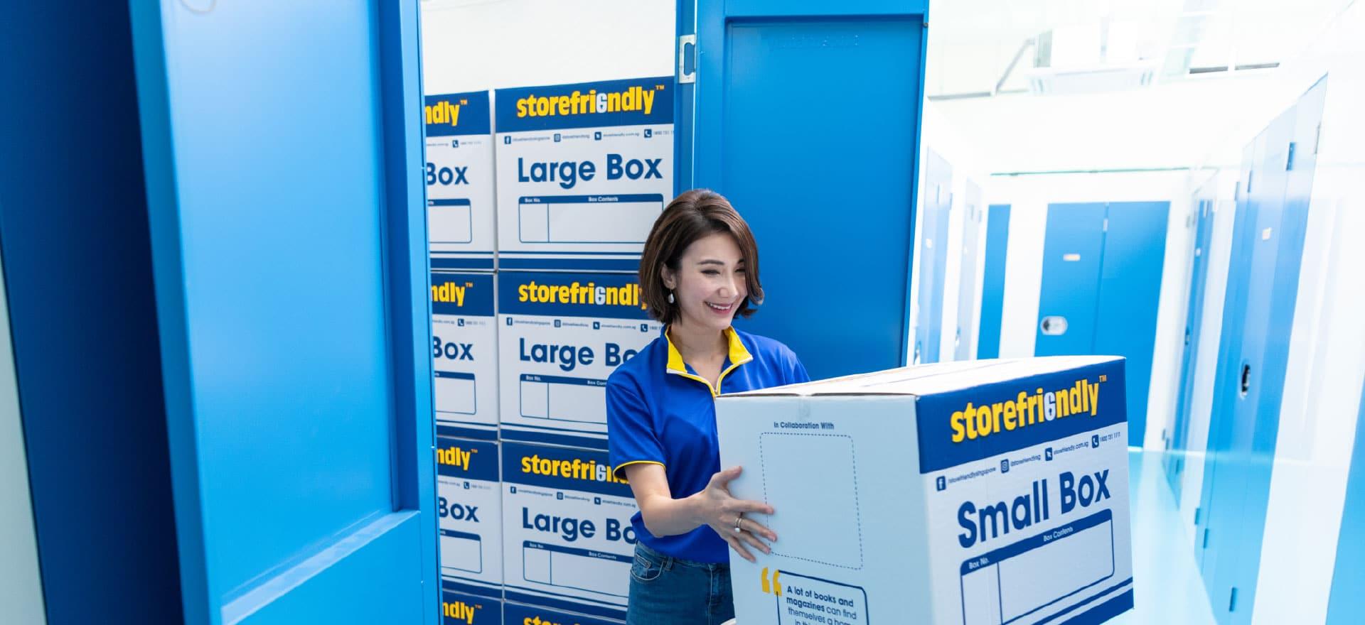 Women holding store friendly box