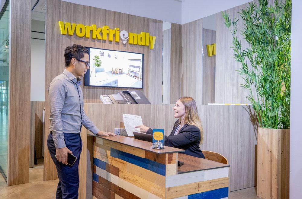 A man talking to a workfriendly receptionist
