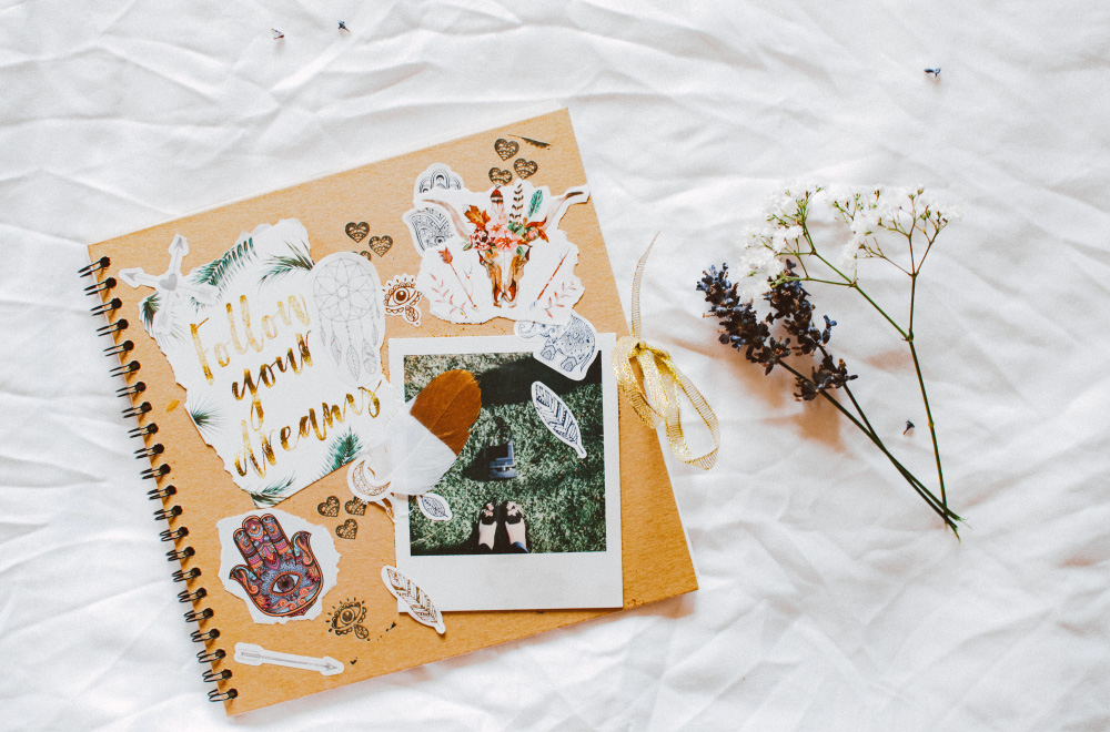 Flowers right next to a scrap book