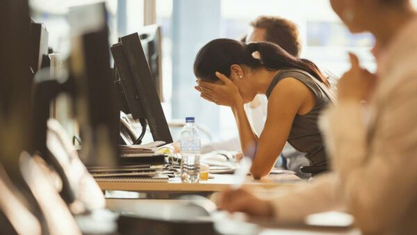 A woman who is stressed out at work