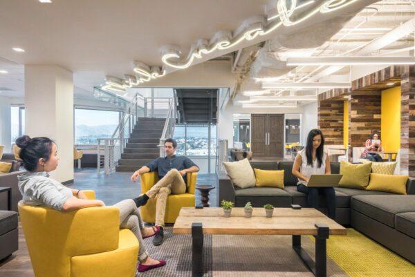people enjoying a stylish office lounge