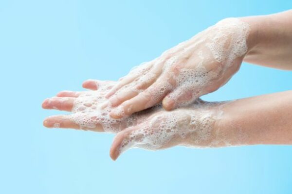 a person washing hands with soap
