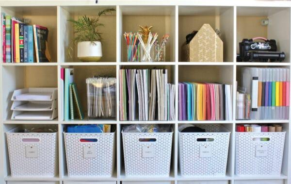 a shelf keeping office items organised