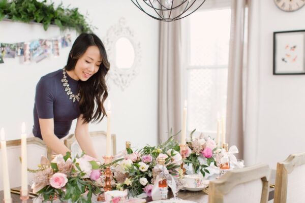 an asian wedding planning arranging the table