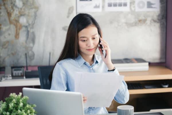 an asian businesswoman reading