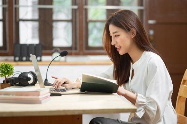 An Asian woman using a laptop