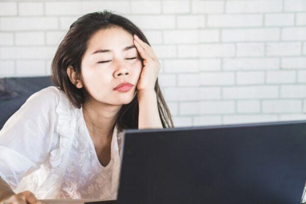 An asian woman sleeping on her office desk